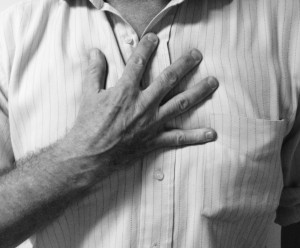 heart pain hand signal on chest