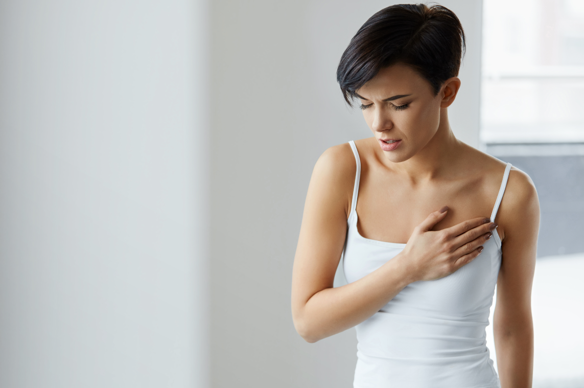 young woman with breast pain